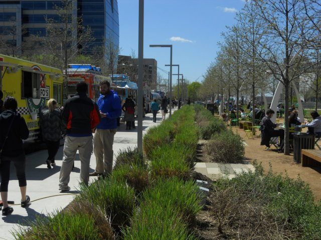 Klyde Warren's Park's street edges are activated with food trucks, clear sight lines, and flexible seating. (Photo by the author)