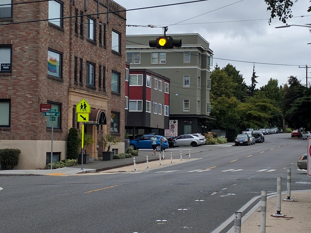 Curb extension using paint and flexible posts at 12th Ave E and E Mercer St. (Owen Pickford)