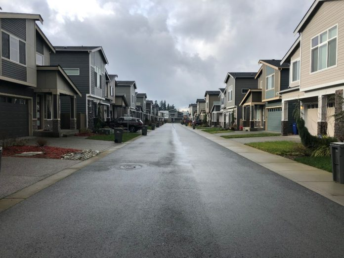 Snohomish County suburban sprawl. A view of 192 Place SE located within the unincorporated Bothell urban growth area. This is one of many private streets in this development, a mechanism that allows for the construction and upkeep of the road to be placed on homeowners associations instead of a municipality. (Photo by Ray Dubicki)